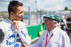 Alex Albon of Scuderia Toro Rosso and Thailand with Sir Jackie Stewart of Scotland